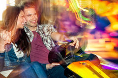 Young couple in love in a bumper car / dodgem ride Stock Photos