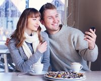 Young Couple in Love in cafe Royalty Free Stock Image