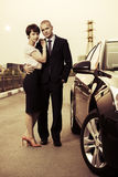 Young fashion couple in love next to car Royalty Free Stock Photos