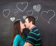 Young couple in love. Chalk drawing. On dark background Royalty Free Stock Image