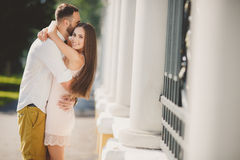 A young couple in love in the city Park in the summer. A young couple, a men of Caucasian appearance, with short hair and a beautiful beard, white shirt and bow royalty free stock photo