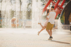 A young couple in love in the city Park in the summer. Royalty Free Stock Photo