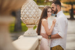 A young couple in love in the city Park in the summer. Royalty Free Stock Photos