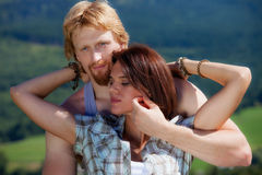 Young couple in love. At countryside summer landscape royalty free stock image