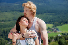 Young couple in love. At countryside summer landscape Stock Photography