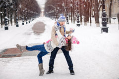 Young couple in love dancing in winter Park. stock photo