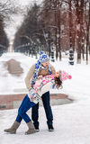 Young couple in love dancing in winter Park. royalty free stock photos