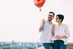 Young couple in love dating and smiling outdoor Stock Images