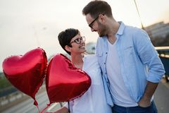 Young couple in love dating and smiling outdoor Royalty Free Stock Images