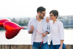 Young couple in love dating and smiling outdoor Stock Photos
