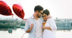 Young couple in love dating and smiling outdoor. On valentine day Royalty Free Stock Photography