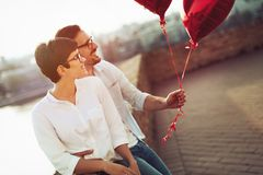 Young couple in love dating and smiling outdoor Stock Image