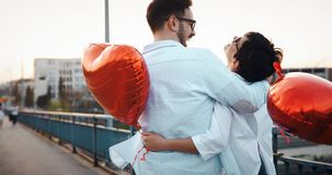 Young couple in love dating and smiling outdoor. On valentine day Stock Photos