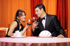 Young couple in love drinking wine Stock Image