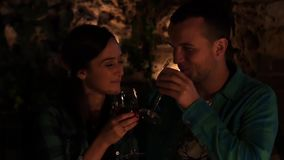 Young couple in love drinking wine and kissing by stock footage