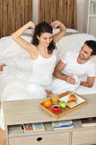 Young couple in love eating breakfast. Young couple in love enjoying breakfast in bed Stock Photos