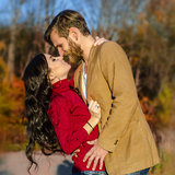 Young Couple in love. Embrace on a background of autumn park Stock Photography