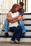 Young Couple In Love Embrace On Steps Royalty Free Stock Photography