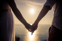 Young couple in love enjoying the view on a cape in Thailand royalty free stock photography
