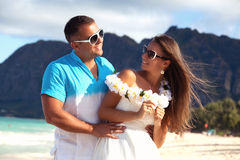 Young couple in love feeling happy on the Hawaiian beach Stock Photography