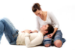 Young couple in love is on the floor. Beautiful young couple in love is on the floor Royalty Free Stock Photo