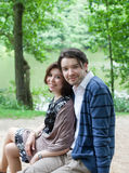 Young couple in love in forest stock photos