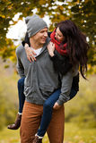Young couple in love frolicking in a park Royalty Free Stock Photo