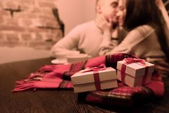 Young Couple in Love with Gifts. Valentine`s Day. Copy Space. Background royalty free stock image