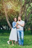 Couple in love have a rest in the summer Apple orchard Stock Photos