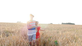 Young couple in love have romance and fun at wheat field in summer stock footage