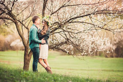 Young couple in love having a date under pink blossom trees. royalty free stock photo