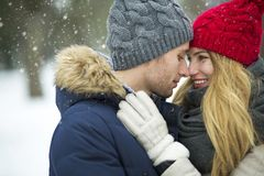 Couple in love in winter scenery Royalty Free Stock Images