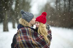Couple wrapped in blanket outdoors Royalty Free Stock Photo