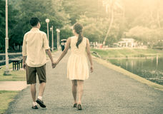 Young couple in love holding hand and walking together Royalty Free Stock Photography