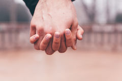 Young couple in love  holding hands Stock Images
