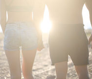 Young couple in love holding hands Stock Photos