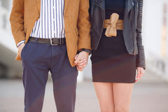 Young couple in love holding hands on the street royalty free stock images