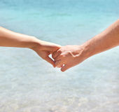 Young couple in love holding hands Royalty Free Stock Images