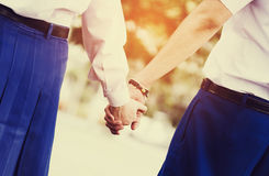 Young couple in love holding hands in summer, vintage tone Stock Photos