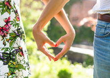 Young couple in love holding hands on the sunset during summer evening Royalty Free Stock Photo