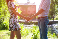 Young couple in love holding hands on the sunset Royalty Free Stock Photo
