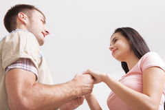 Young couple in love holding hands. Unusually top view. Royalty Free Stock Images