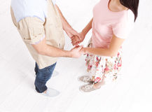 Young couple in love holding hands. Unusually top view. Stock Photos