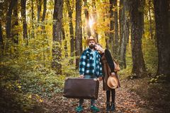 Young couple in love holding hands and walking through a park on a sunny autumn day. Beautiful young couple walking in. Autumn park. Couple in love in autumn royalty free stock photo