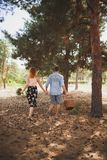 A young couple got out of town for a walk in the woods. The concept of active rest stock photos