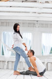 Young couple  in love at home, man sitting on the floor Royalty Free Stock Photos