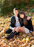 Young couple in love hug in autumn outdoors stock photos
