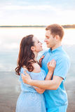 Young couple in love hug each other at the lake outdoor in summer day, , harmony concept Royalty Free Stock Photography