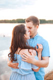 Young couple in love hug each other at the lake outdoor in summer day, , harmony concept Royalty Free Stock Images