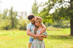 Young couple in love hug each other in nature Stock Photography